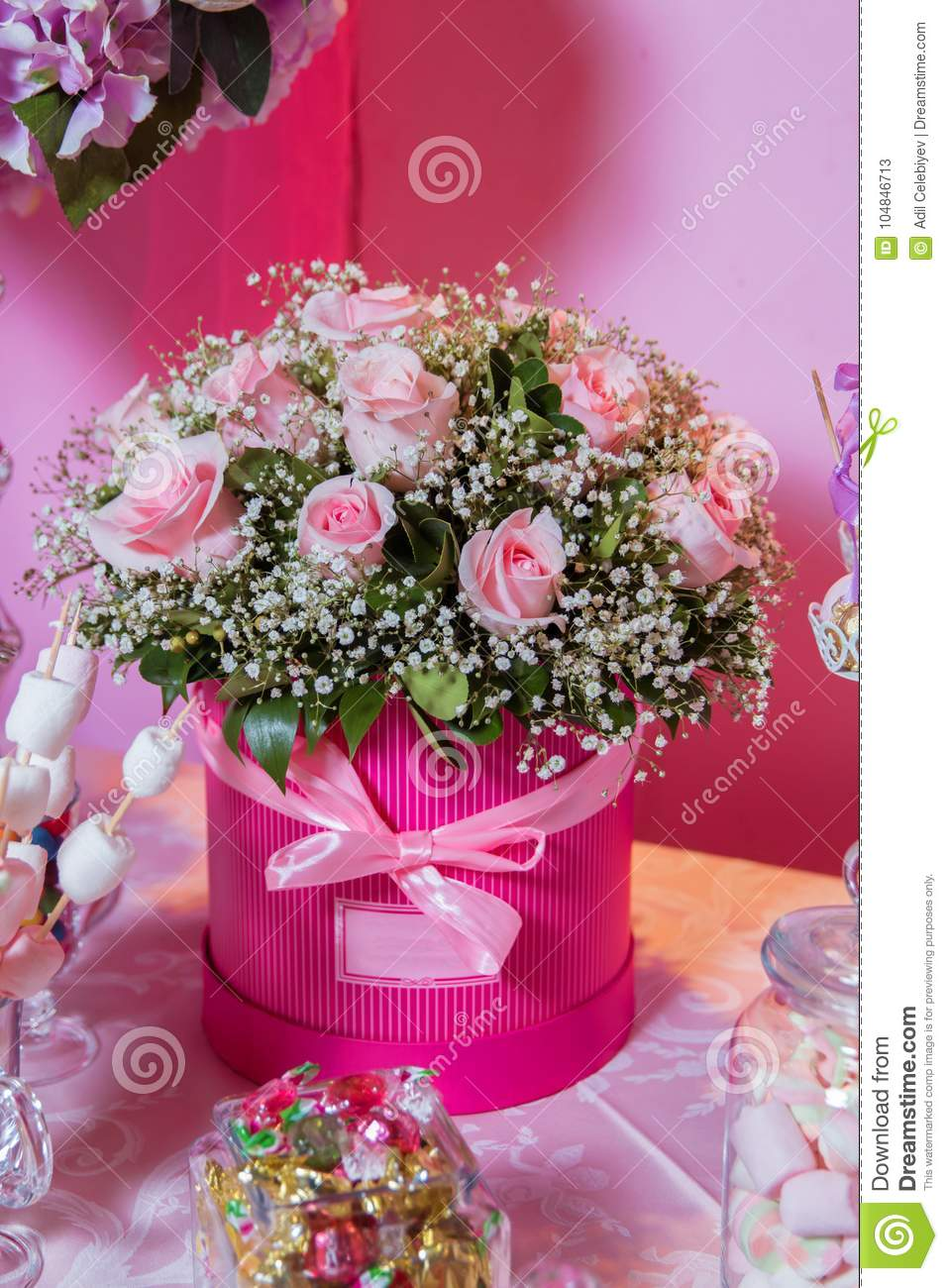 Candy bar bright white interior with lots of pink flowers pink royalty free stock photo izmirmasajfo Choice Image