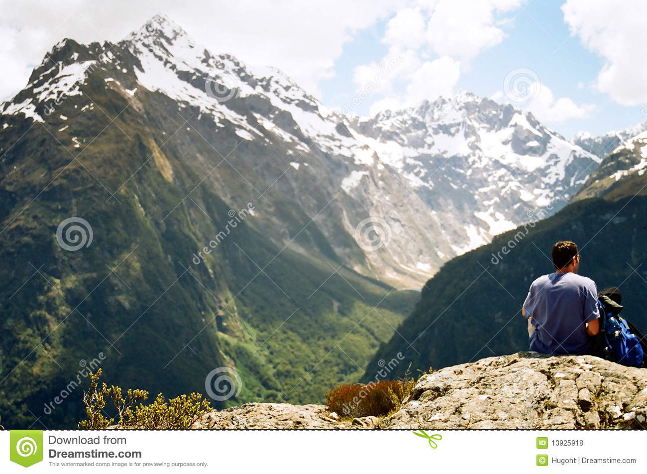 Man sitting on Key Summit cliff edge in the Routeburn Track, New ...