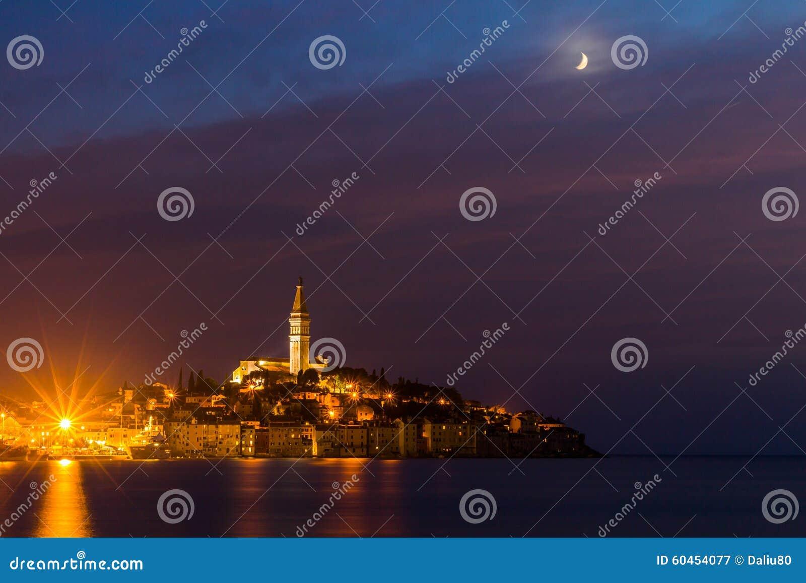 Rovinj old town at night with moon on the colorful sky, Adriatic sea coast of Croatia, Europe