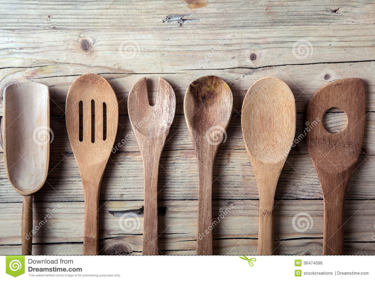 Row Of Assorted Old Wooden Kitchen Utensils Royalty Free Stock Image