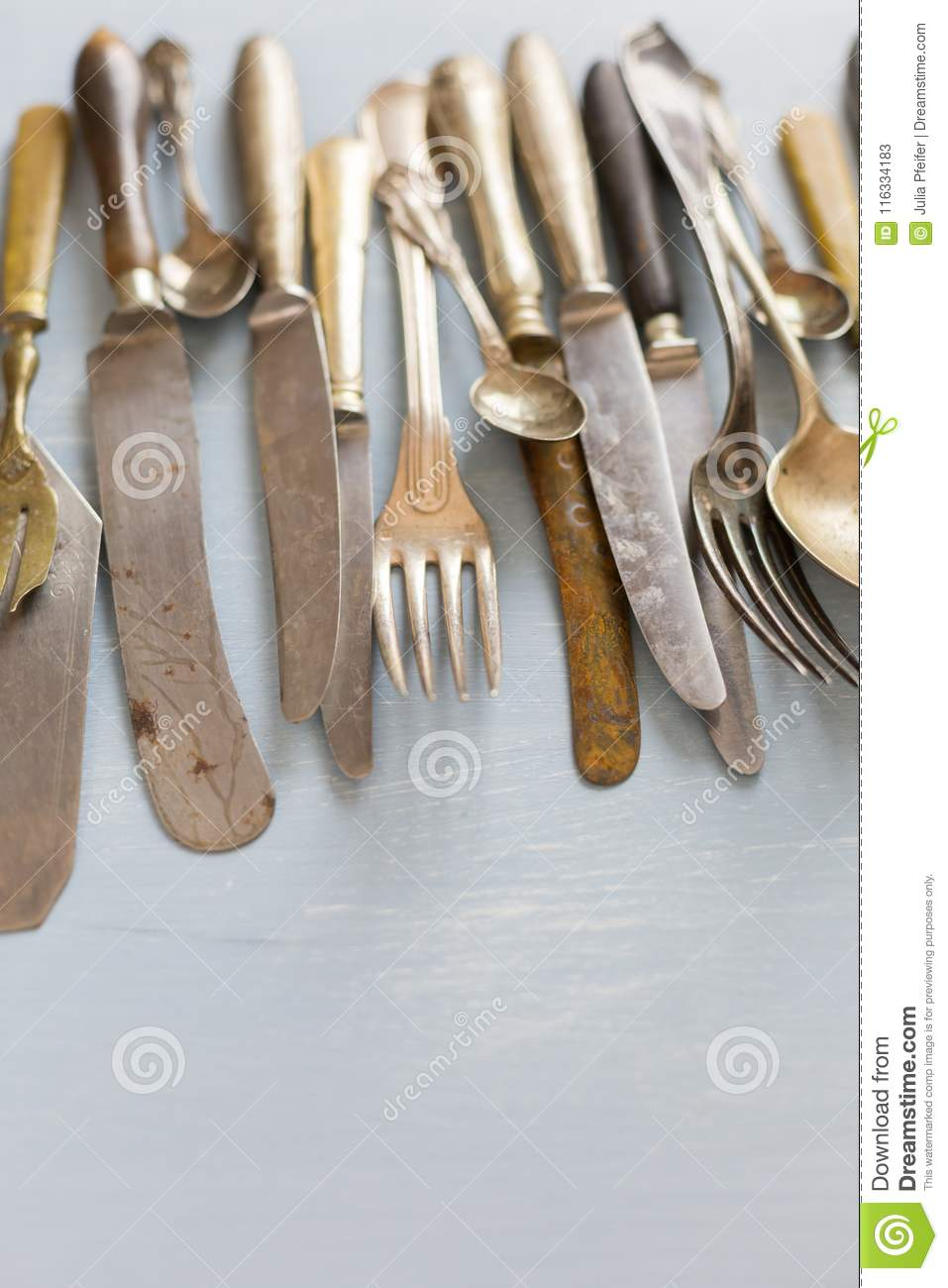 Row of assorted vintage cutlery