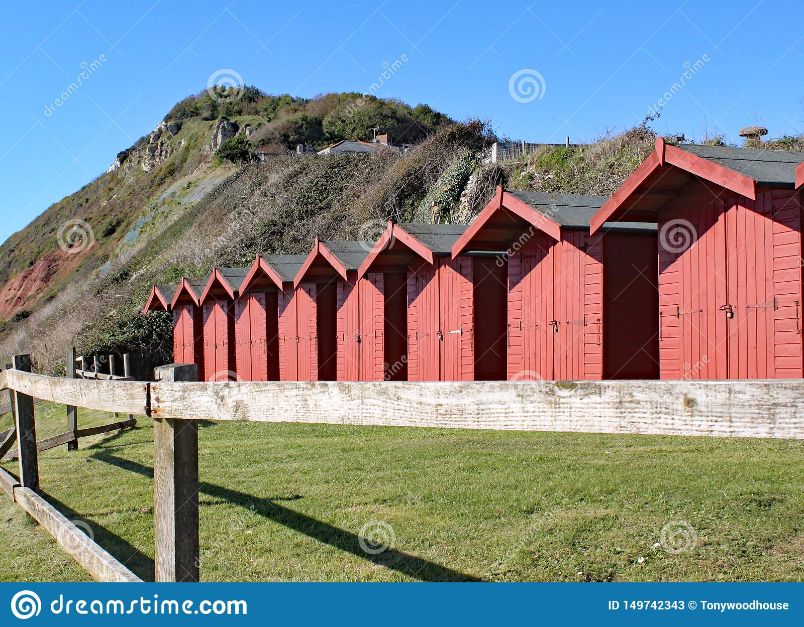 A row of beach huts on the shingle beach at Branscome in Devon, England