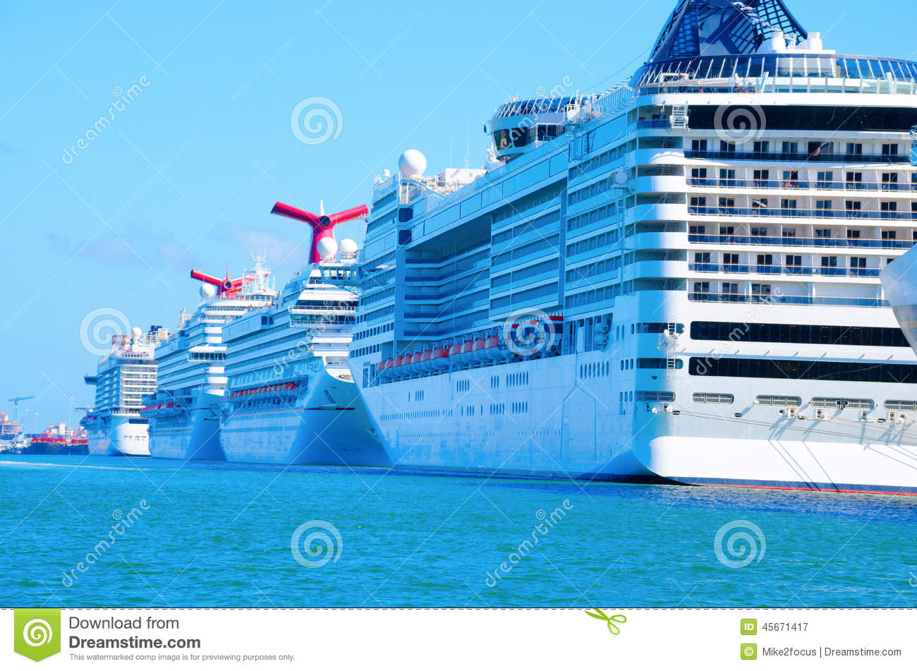 Row Of Big Cruise Ships In Aqua Colored Water Stock Photo