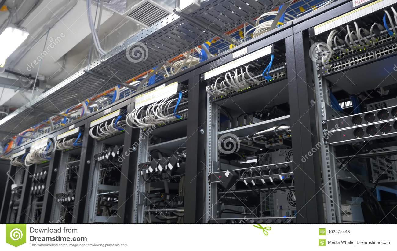 Row Of Bitcoin Miners Set Up On The Wired Shelfs. Computer For ...