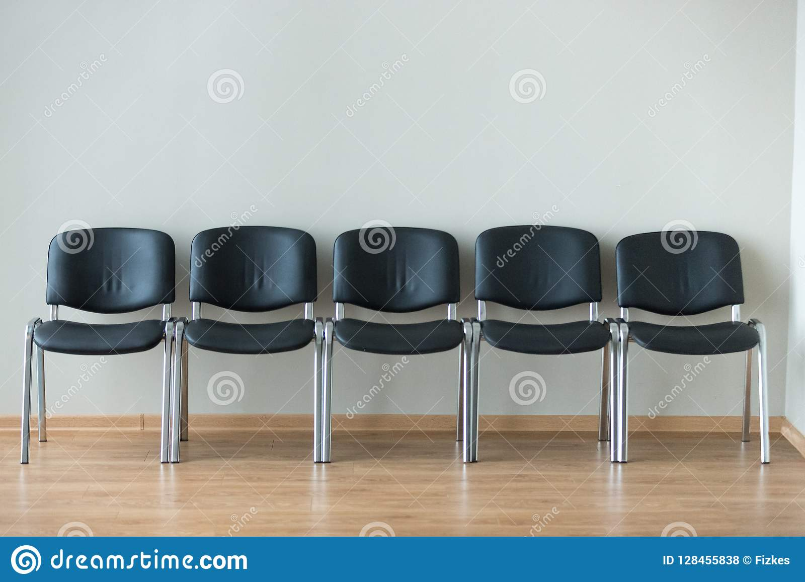 Admirable Row Of Black Office Chairs In Conference Room Stock Photo Download Free Architecture Designs Intelgarnamadebymaigaardcom