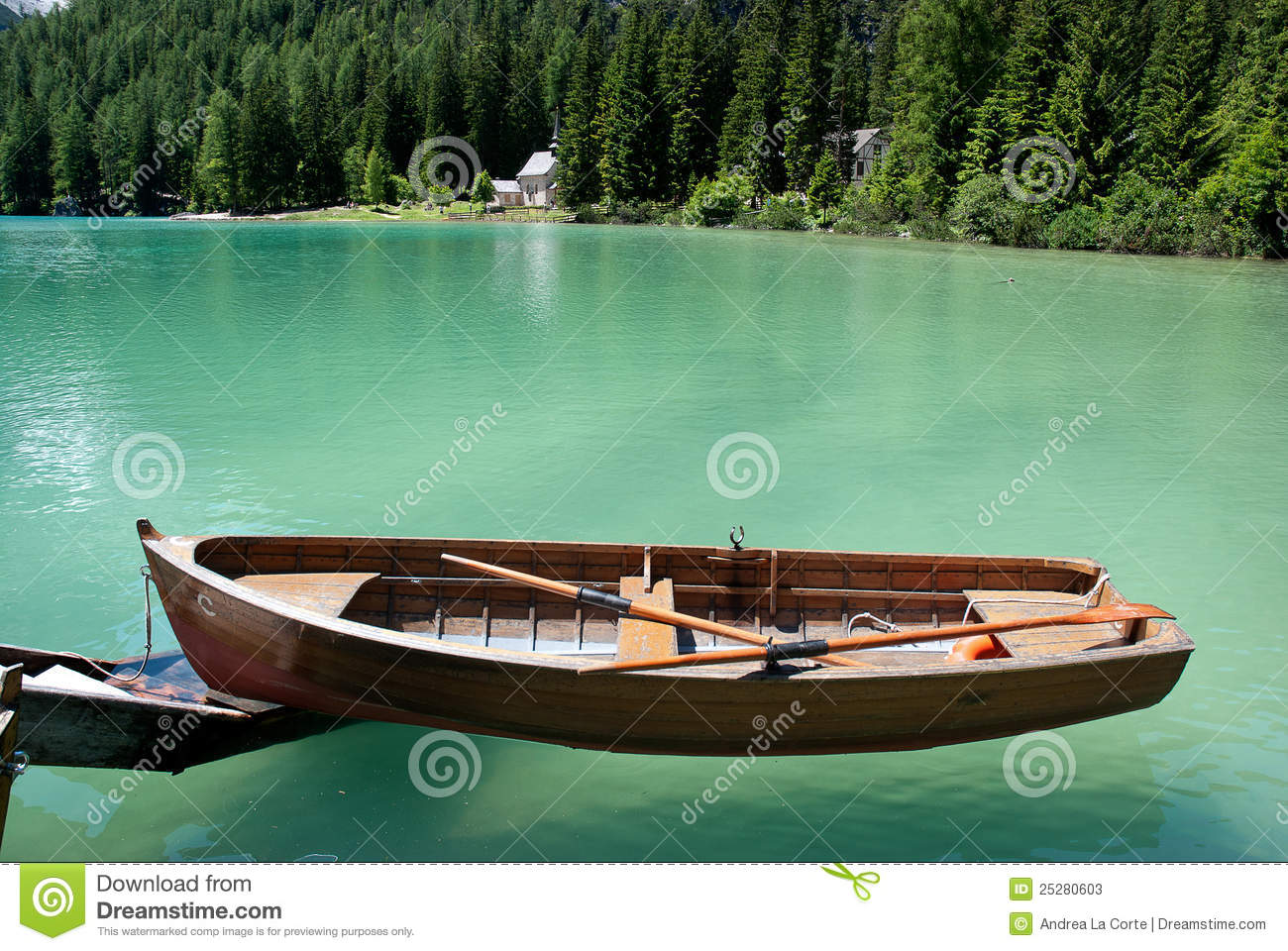 Row Boat Floating On The Water Stock Photos - Image: 25280603