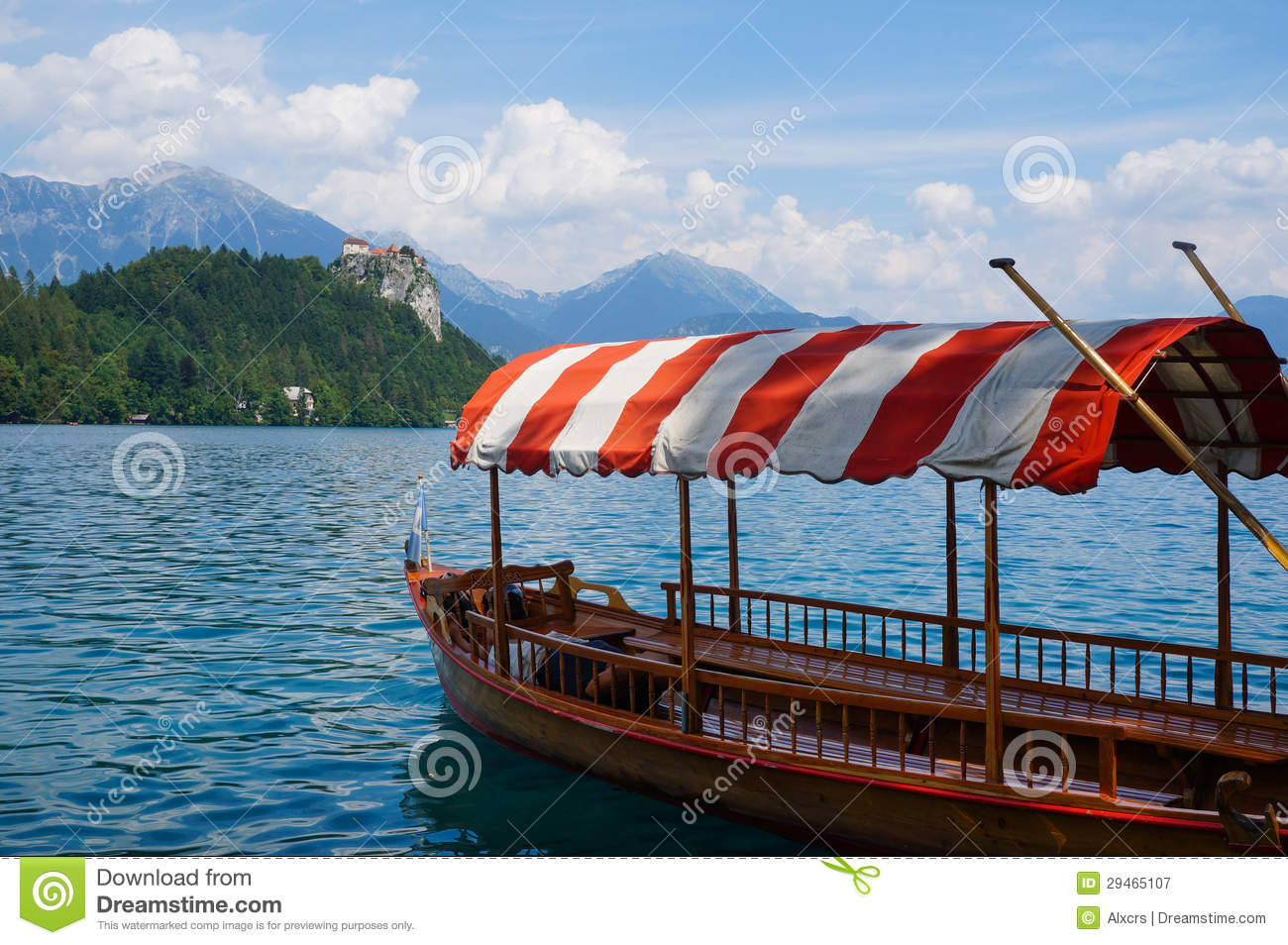 Row boat on Bled Lake, with Bled Castle in the background, Slovenia.