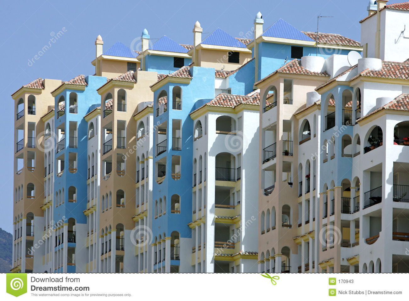 row of colorful sunny apartments in spain stock image - image: 170943