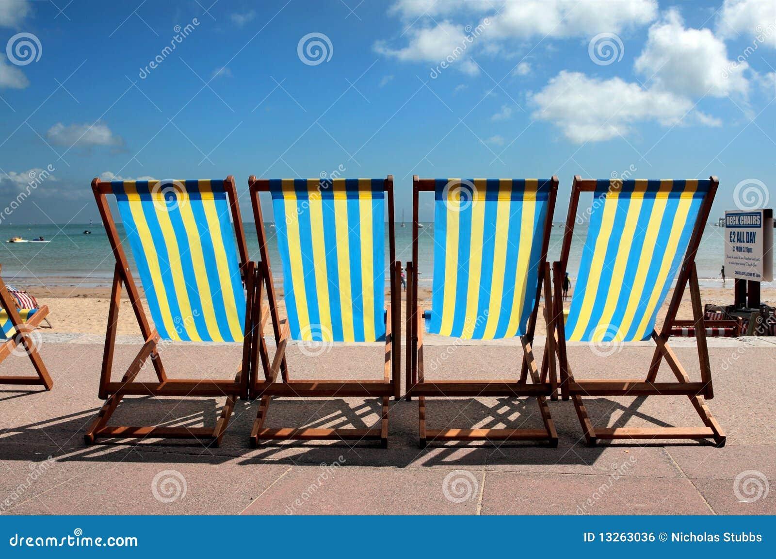 Row of colourful deckchairs on Weymouth beach