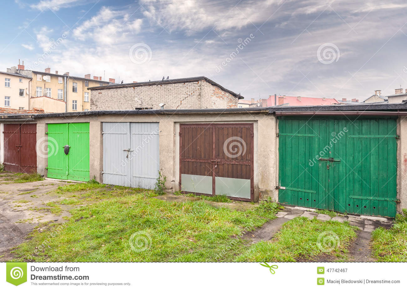 926 #278260 Row Of Garage Doors In Slum Area Stock Photo Image: 47742467 wallpaper Garage Doors In My Area 37451300