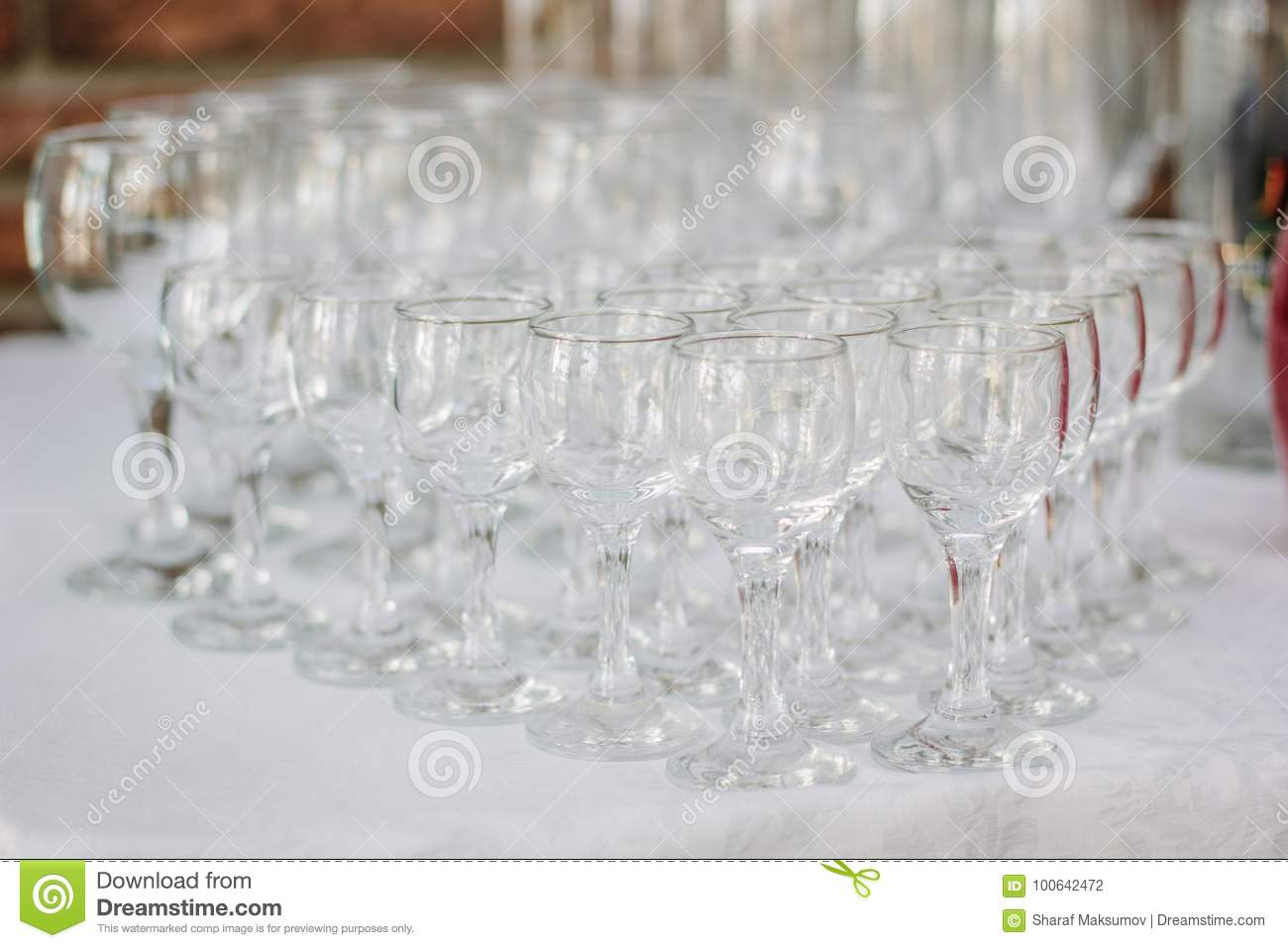 Row of glass on catering event on table.
