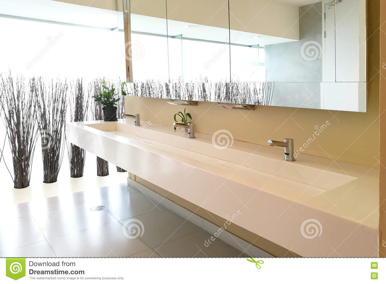 Row Of Hand Washing Sinks In Modern Public Toilet Stock