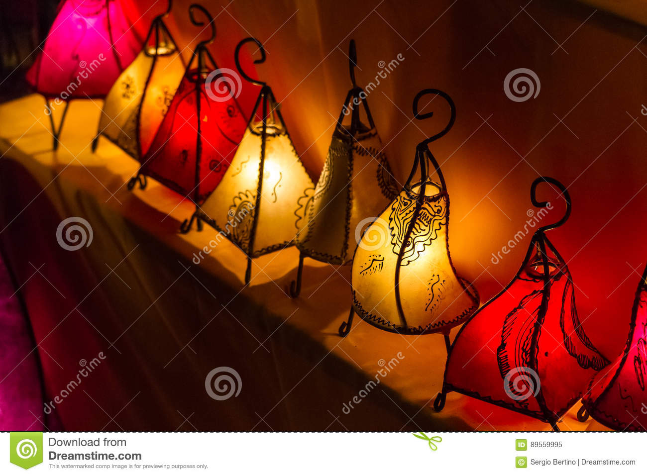 Row of handcrafted colorful glowing lanterns
