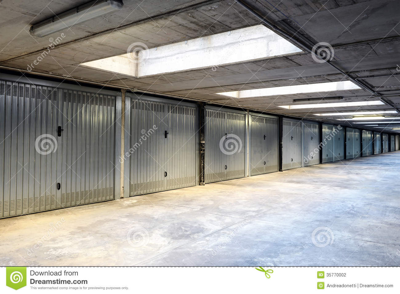 Commercial Steel Garages Inside : Row of internal garages or lock ups stock photography
