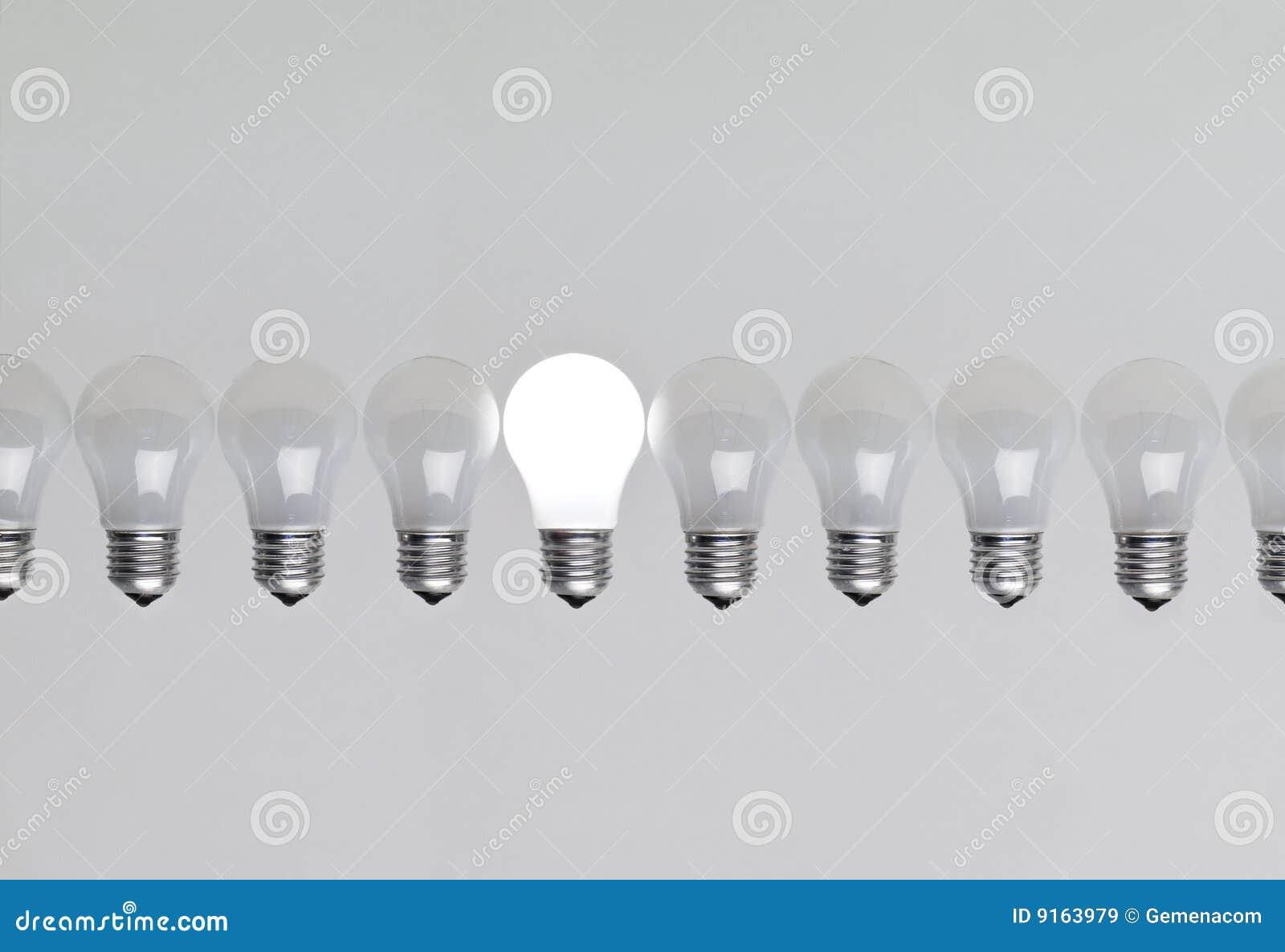 Row of light bulbs stock image. Image of community ...