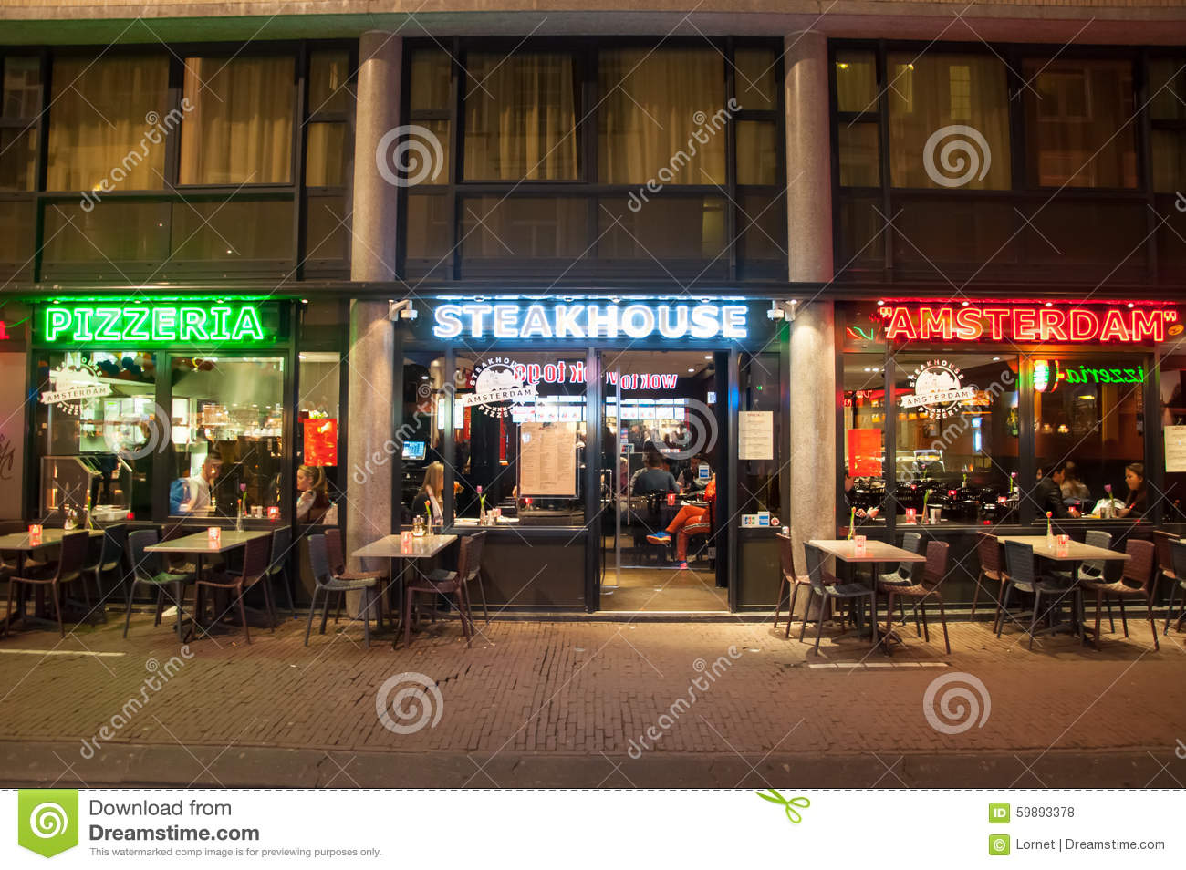 row of local steakhouse and restaurants in red light district in amsterdam the netherlands. Black Bedroom Furniture Sets. Home Design Ideas