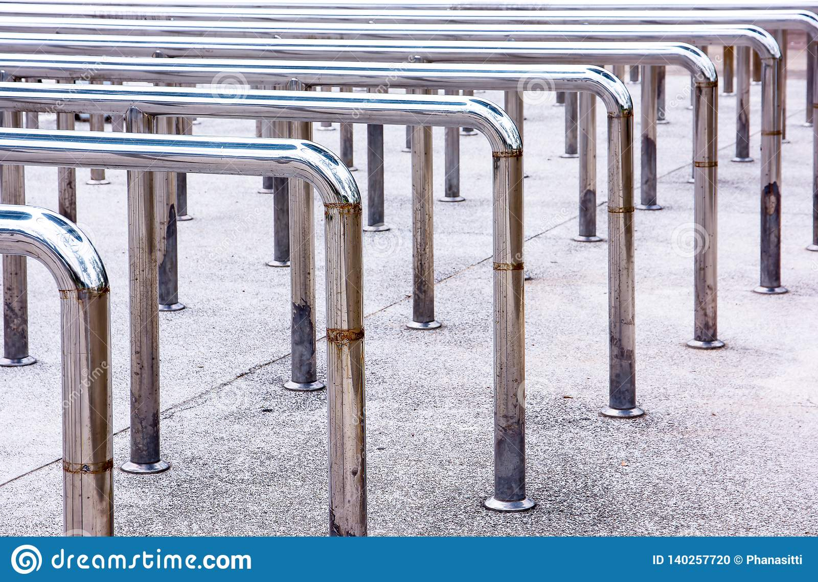 Row of metal hand handrails in the park