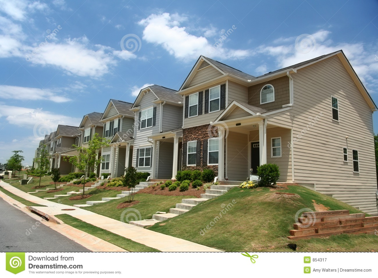 A row of new townhomes royalty free stock photography for Newtown builders