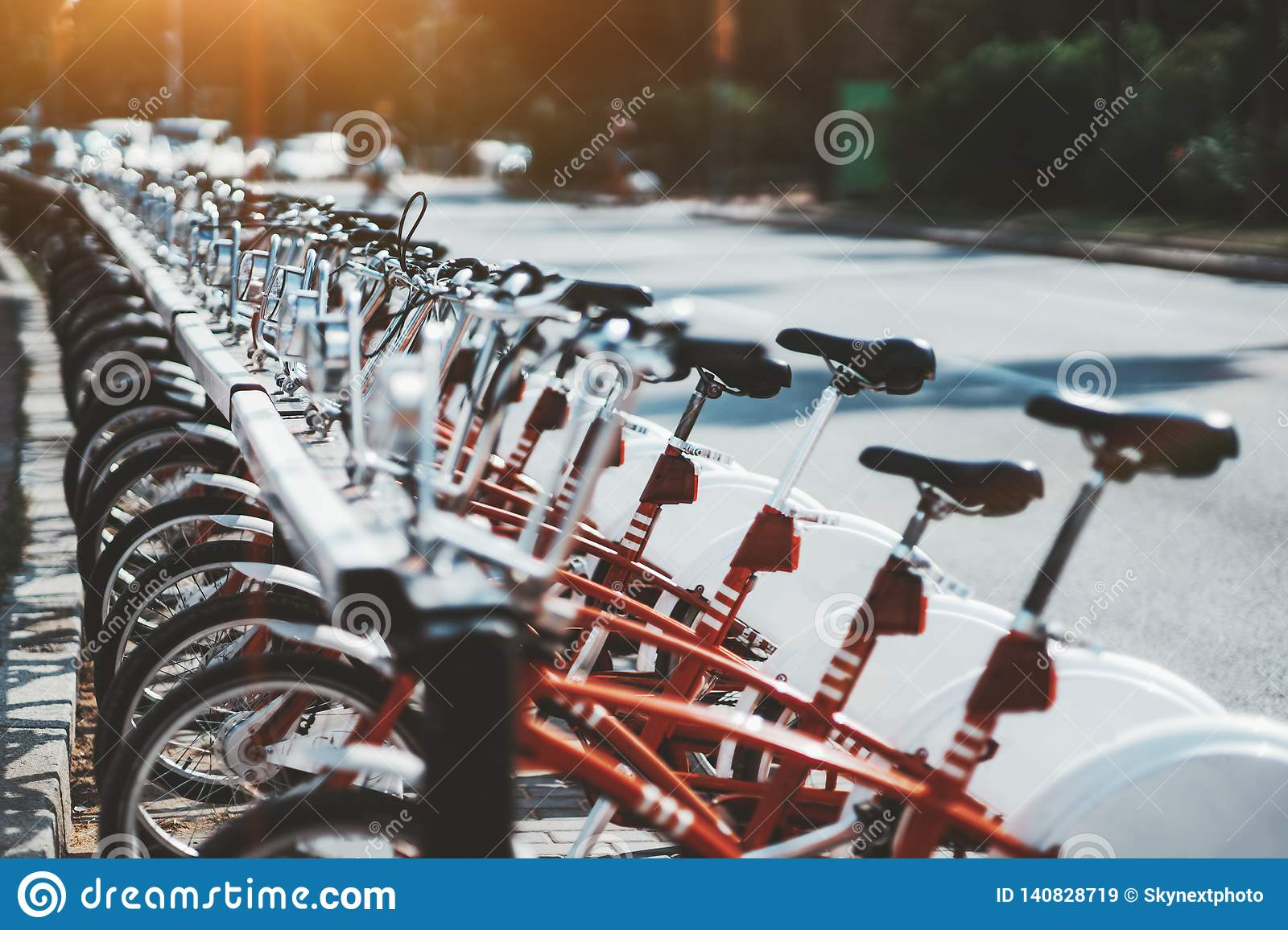 Row of red rental bikes outdoors