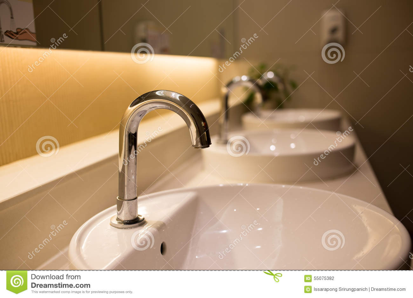 Row of sinks stock photo. Image of bathroom, monochrome - 55075382