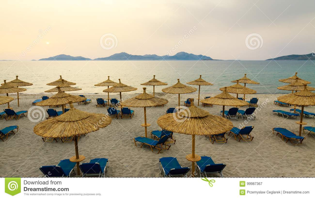 Row Sunbeds And Umbrellas Stock Image Image Of