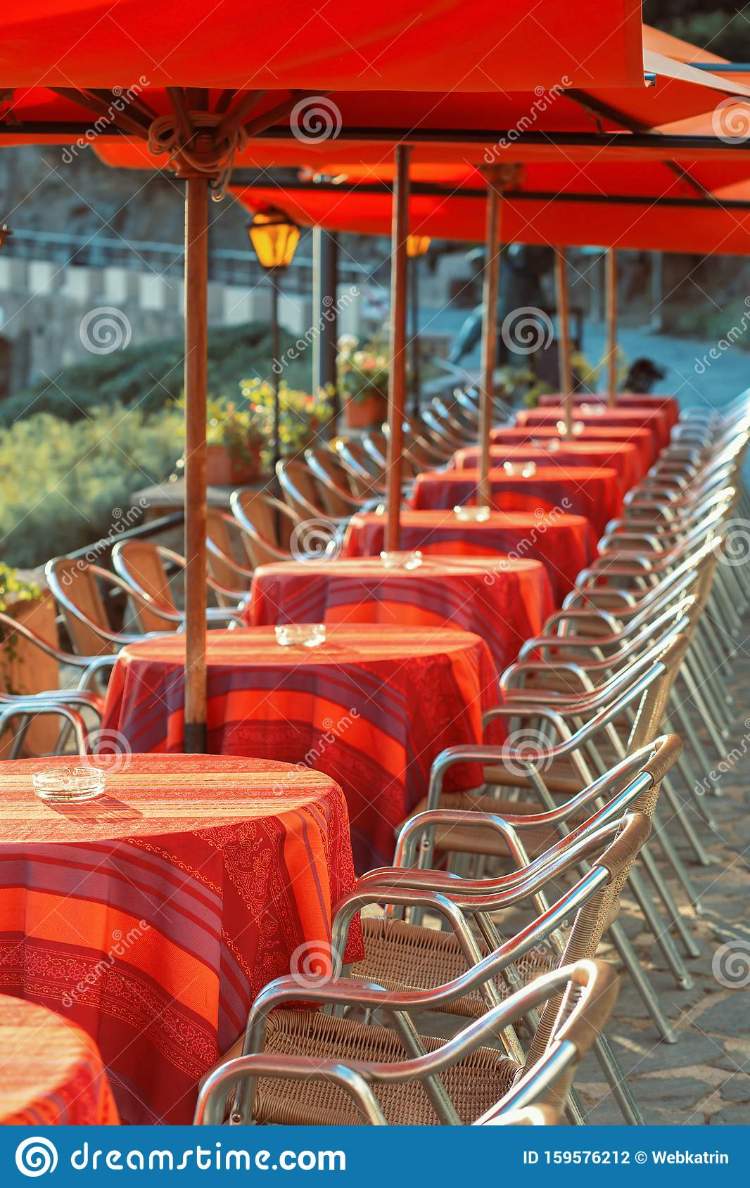 A Row Of Tables With Red Tablecloths On The Open Terrace Of A Restaurant In The Seaside Town Stock Photo Image Of Chair Open 159576212