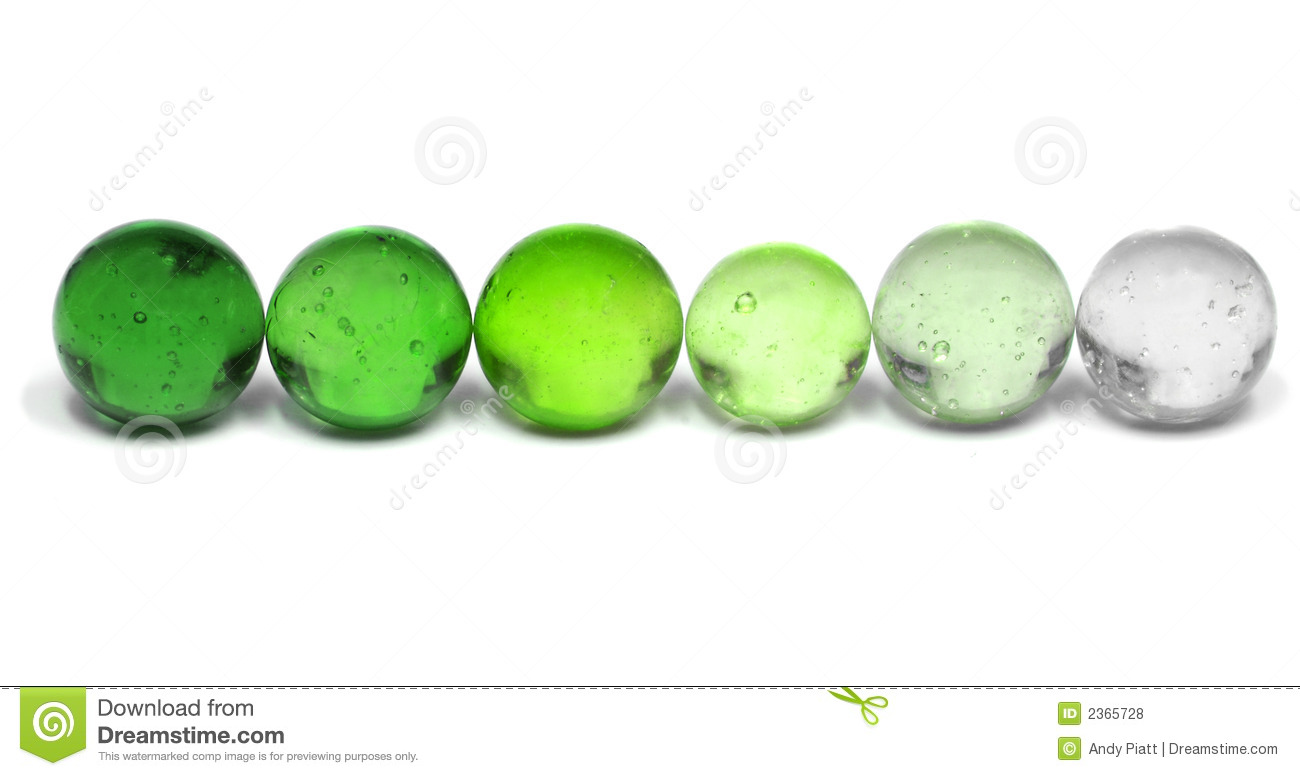 Green Marble Toy : Row of toy glass green marbles stock photo image