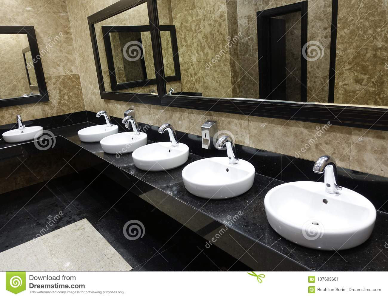Row Of Wash Basins With Mirrors In A Public Toilet Stock Image ...