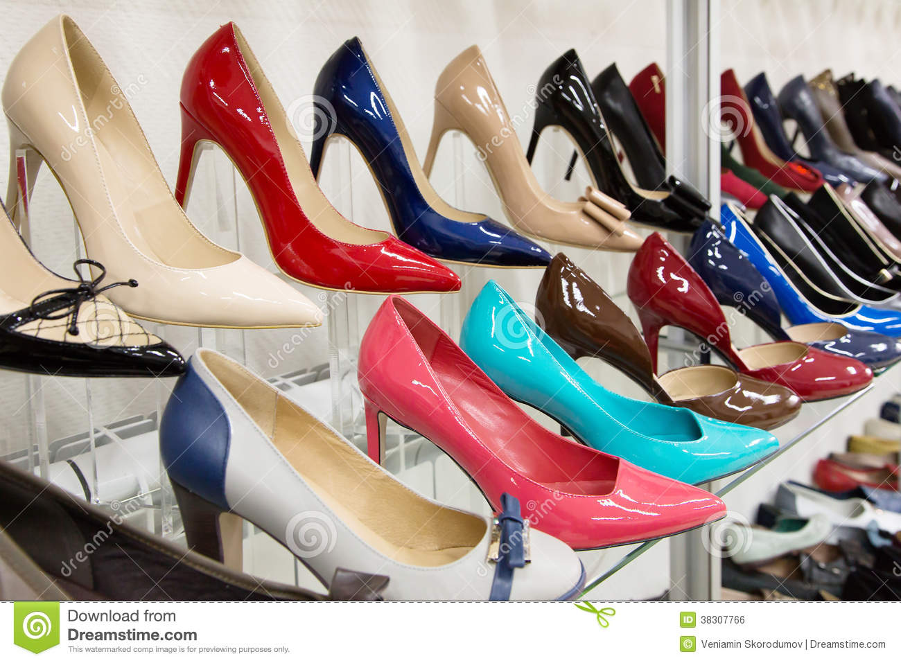 Rows of beautiful women s shoes on store shelves