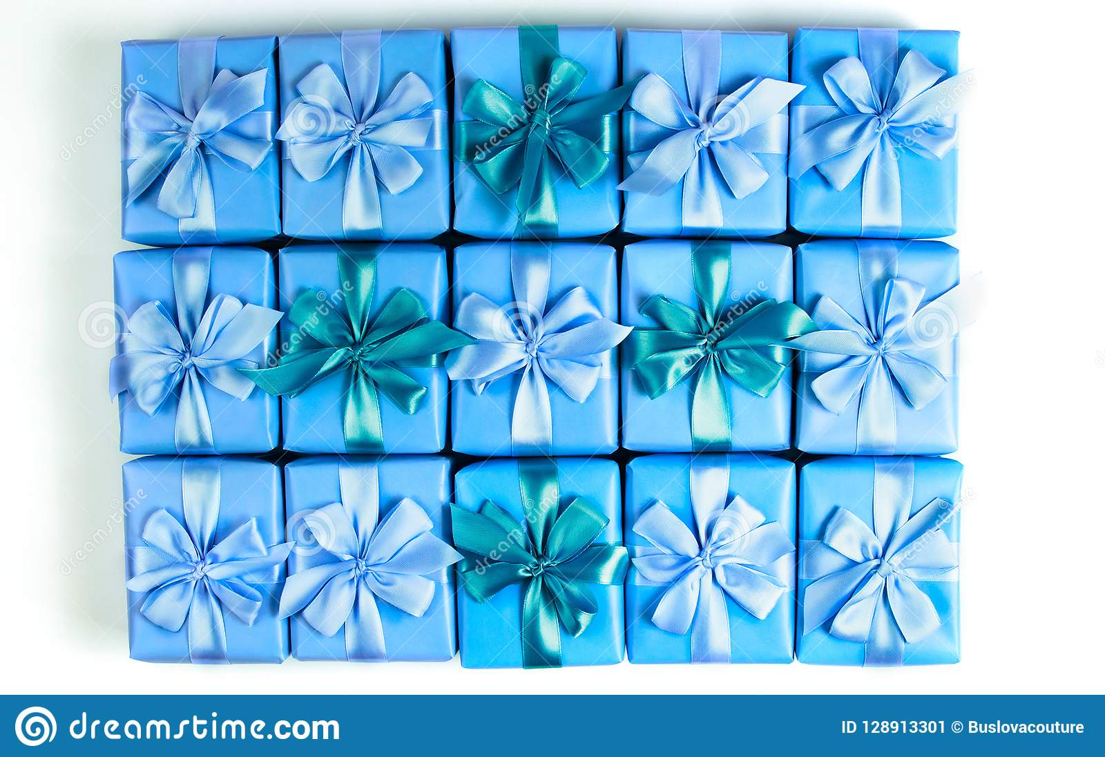 Rows of boxes with gifts decoration ribbon satin bow blue A top view of Flat lay