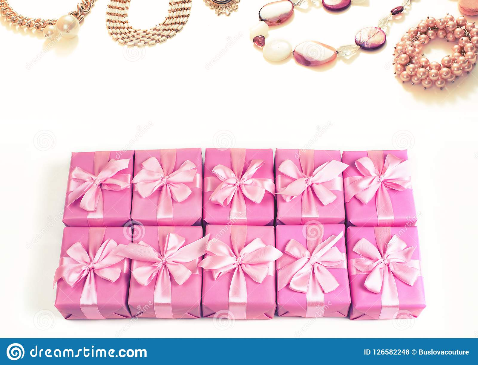 Rows of boxes with gifts decoration ribbon satin bow pink fashion accessories for women jewelry pearl necklace bracelet A top view