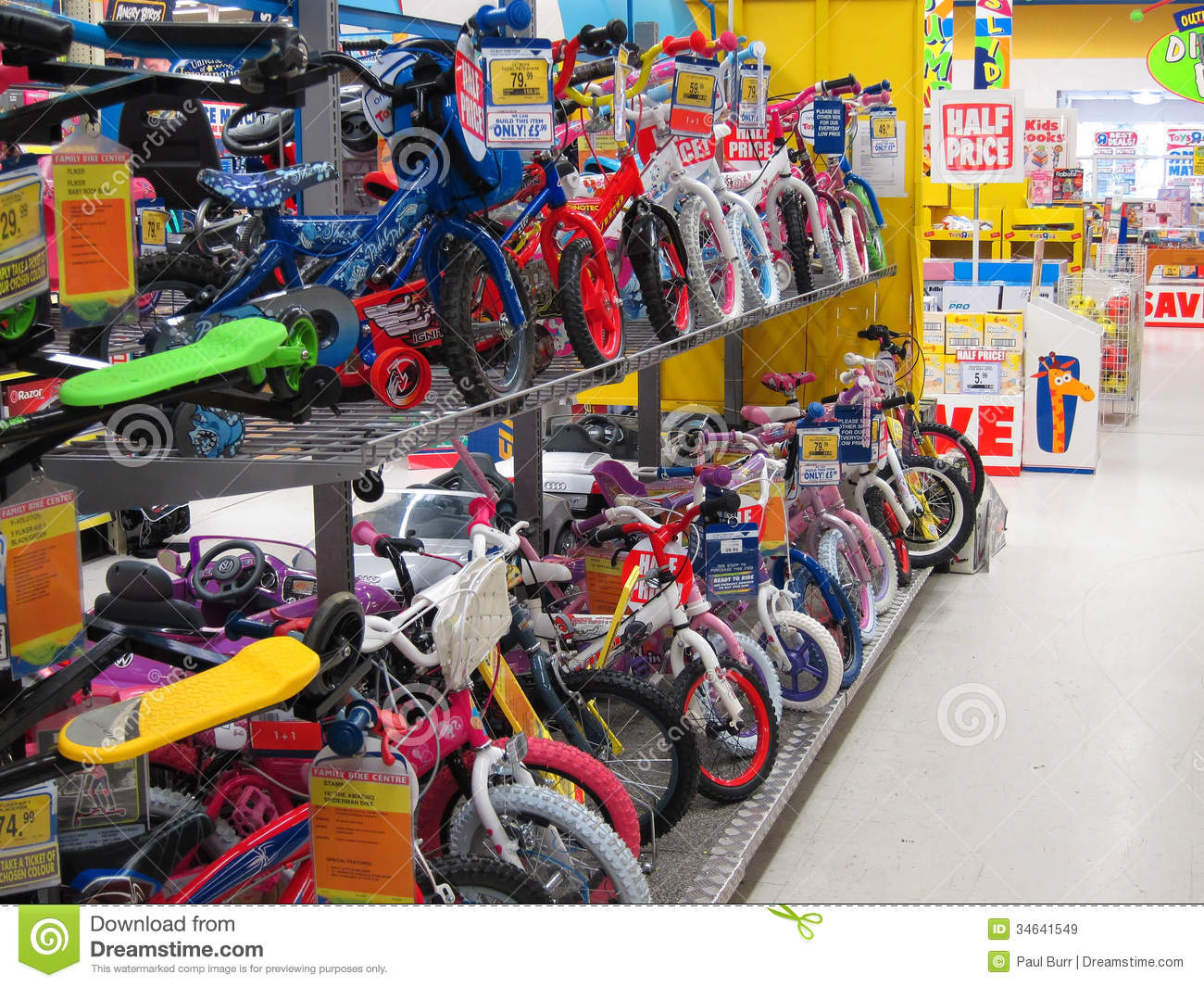 Bikes From Toys R Us : Rows of childrens bikes in a toy store editorial stock