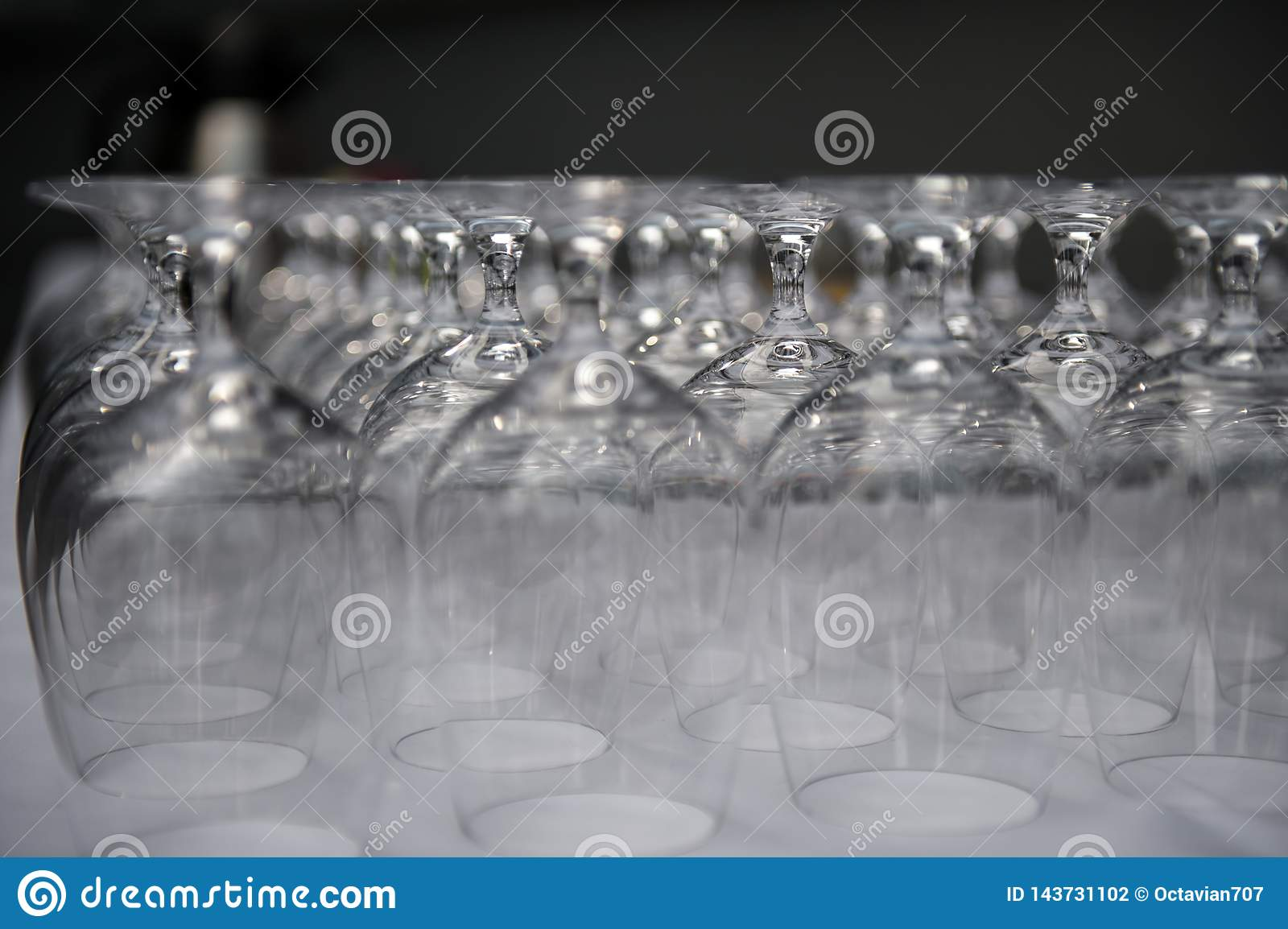 Rows of empty glasses in restaurant