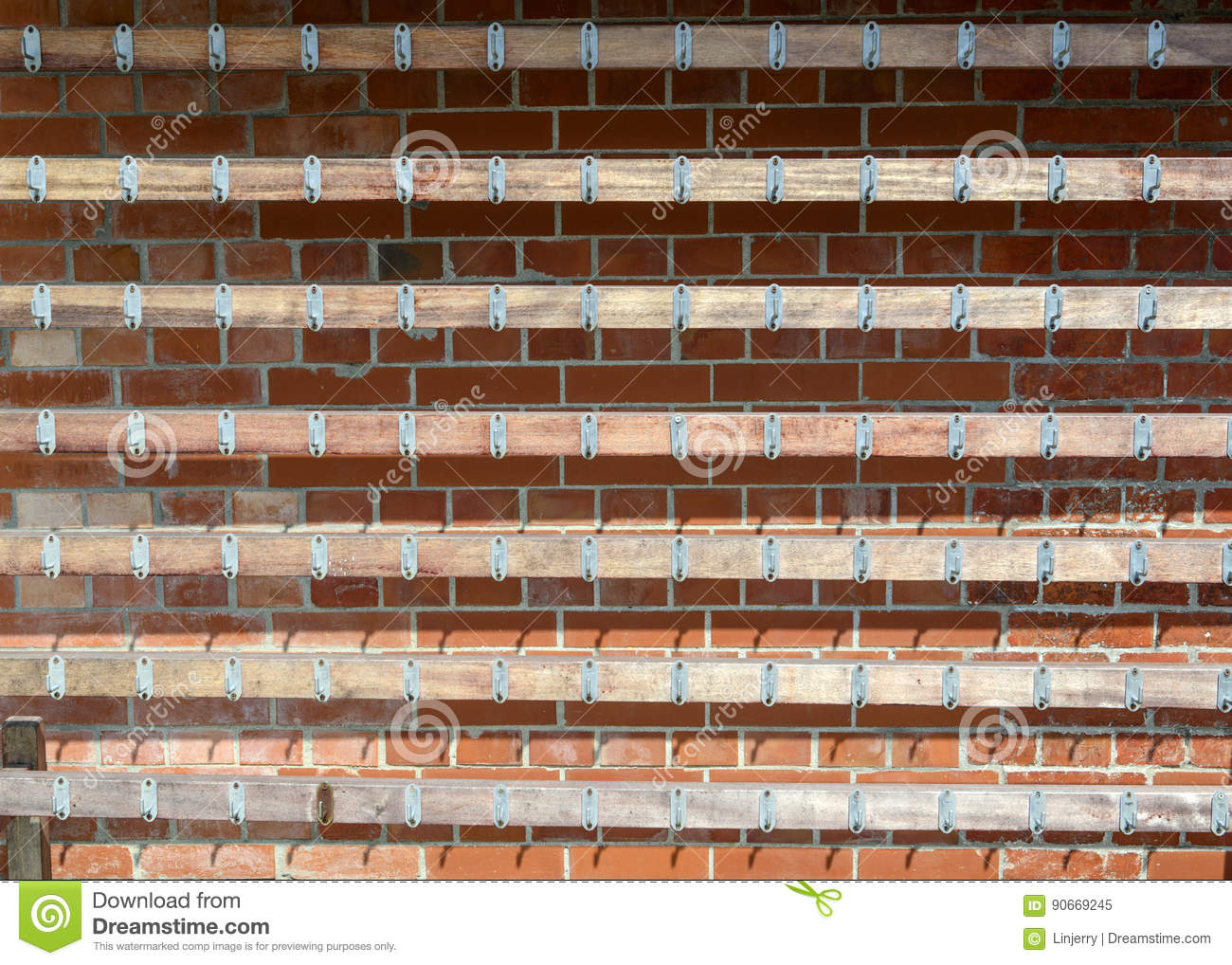 Rows Of Hooks On The Brick Wall Stock Image - Image of collection