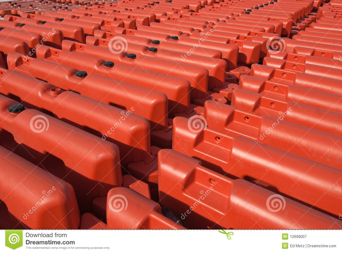 Rows of orange security barriers royalty free stock