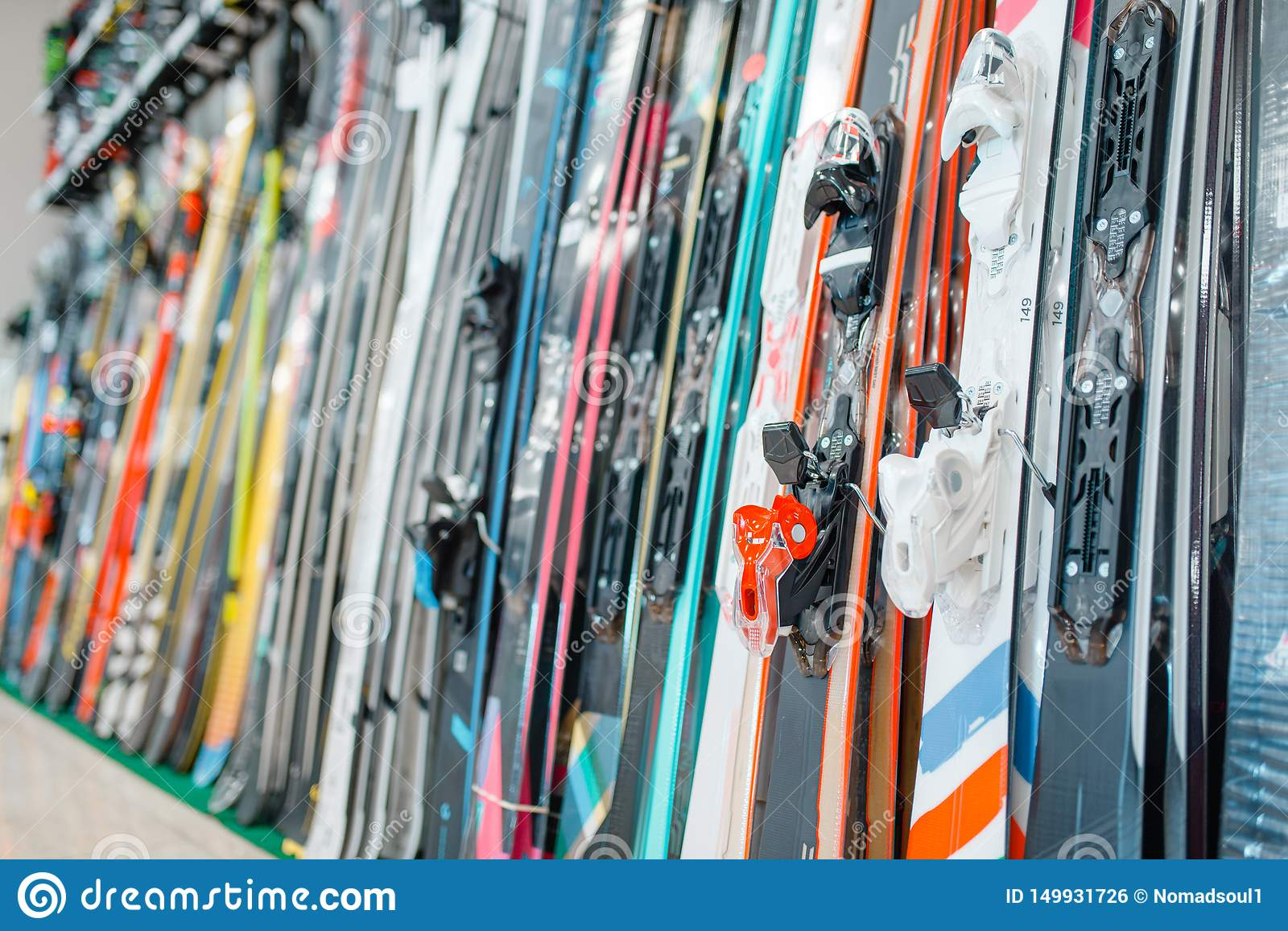 Rows of skis in sports shop, closeup, nobody