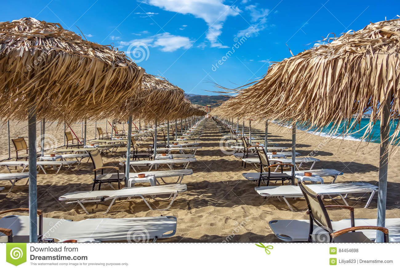 Rows Of Umbrellas And Sunbeds On Empty Beach Stock Photo
