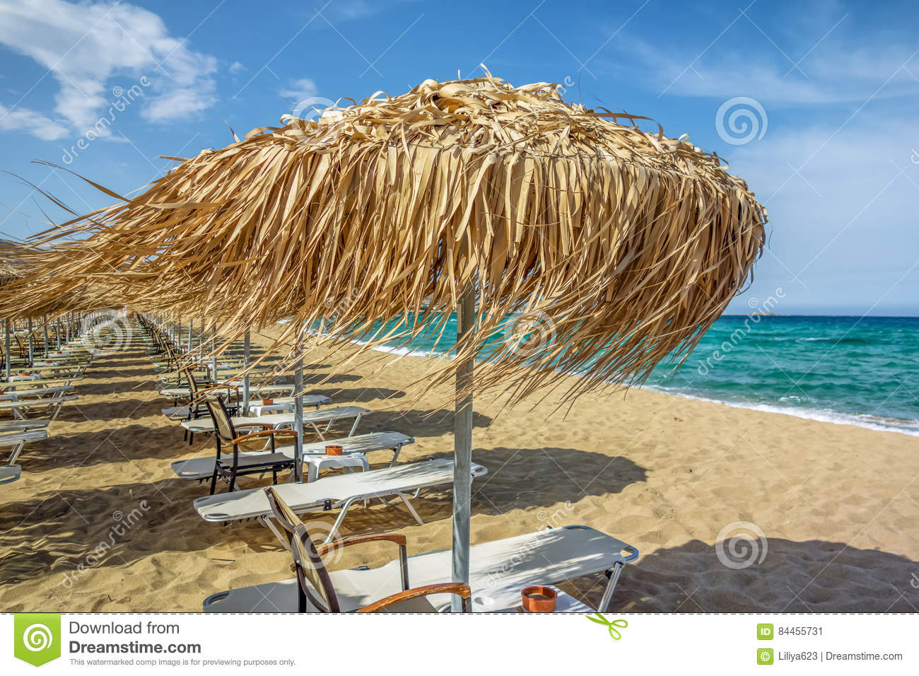 Rows Of Umbrellas And Sunbeds On Empty Beach Stock Image