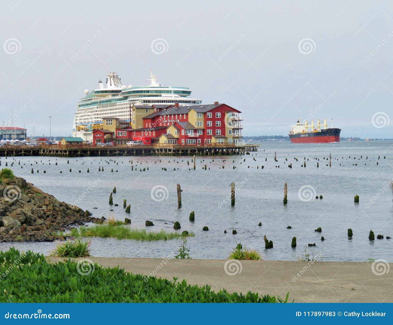 Astoria, Oregon, 9/16/2018, Royal Caribbean`s Explorer of the Seas cruise ship docked along side the Cannery Pier Hotel & Spa