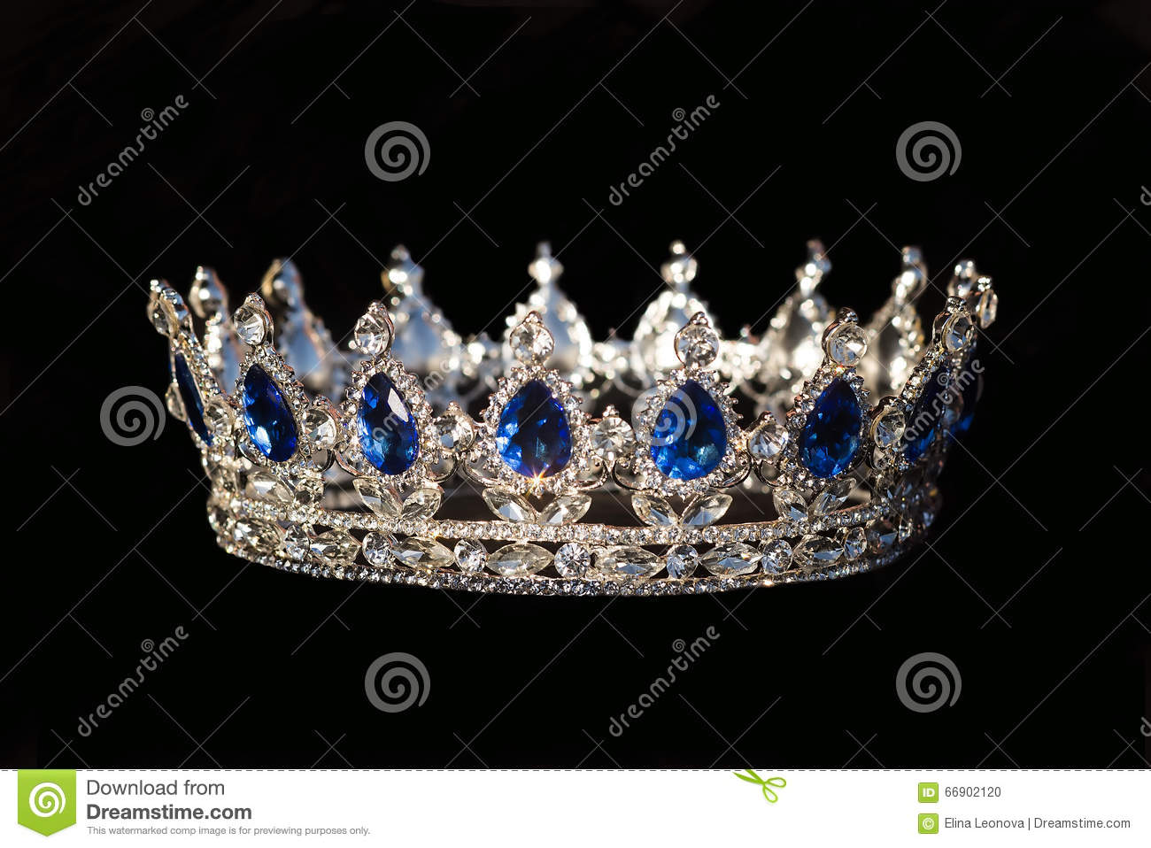 Royal crown with sapphire on black background