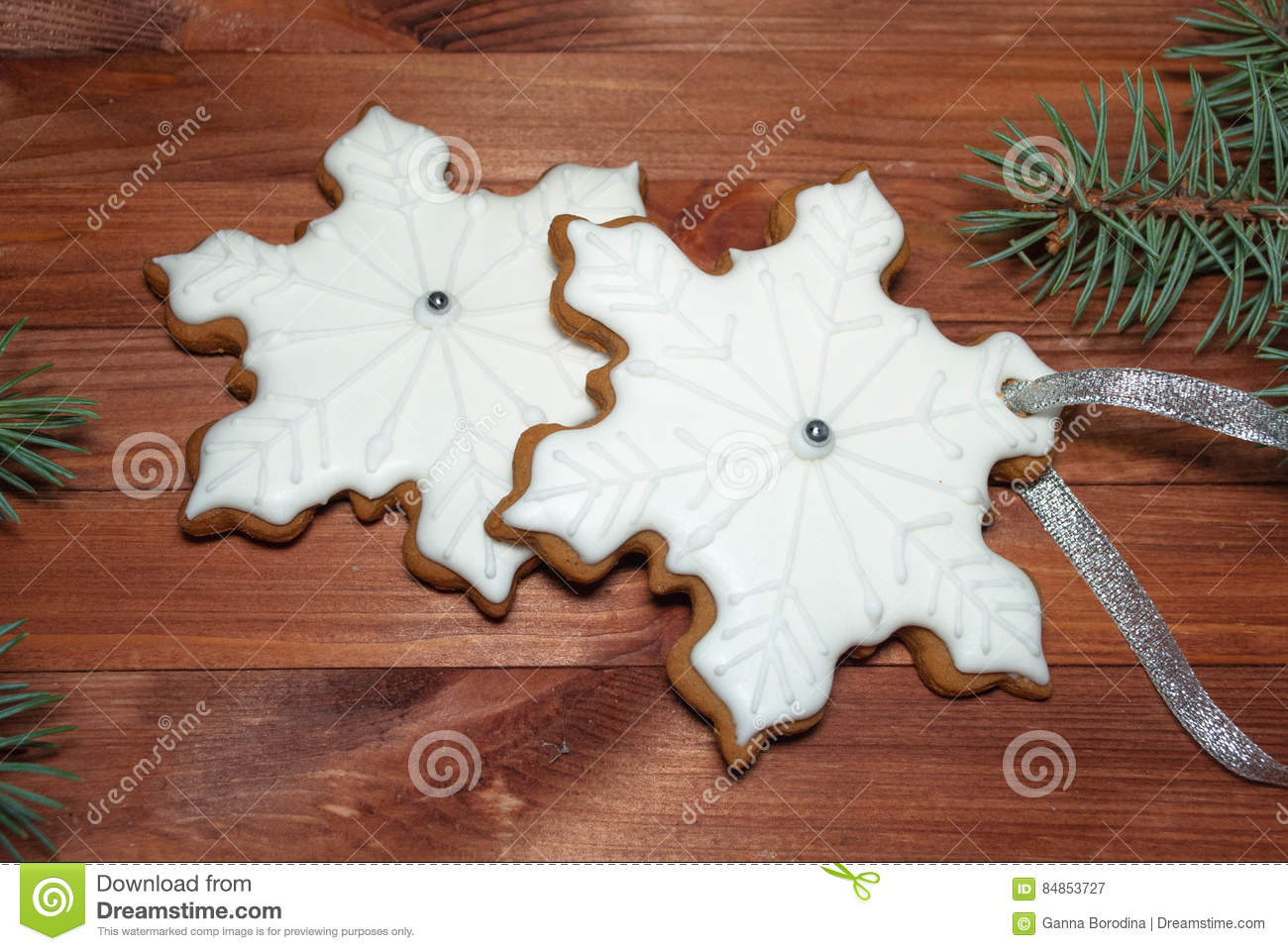 Royal Icing Gingerbread Snowflakes Cookies On Wooden Background