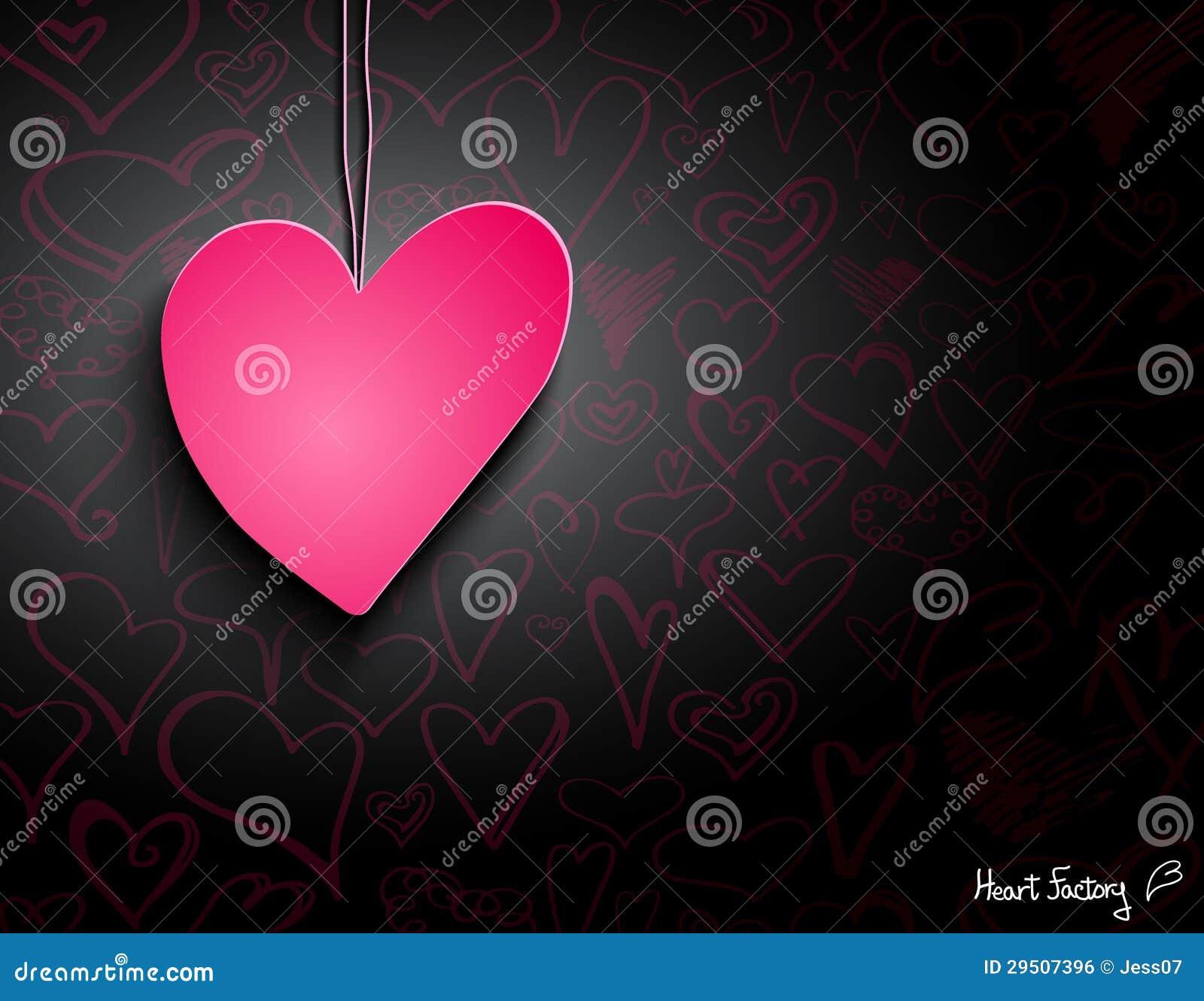Roze document hart op zwart behang