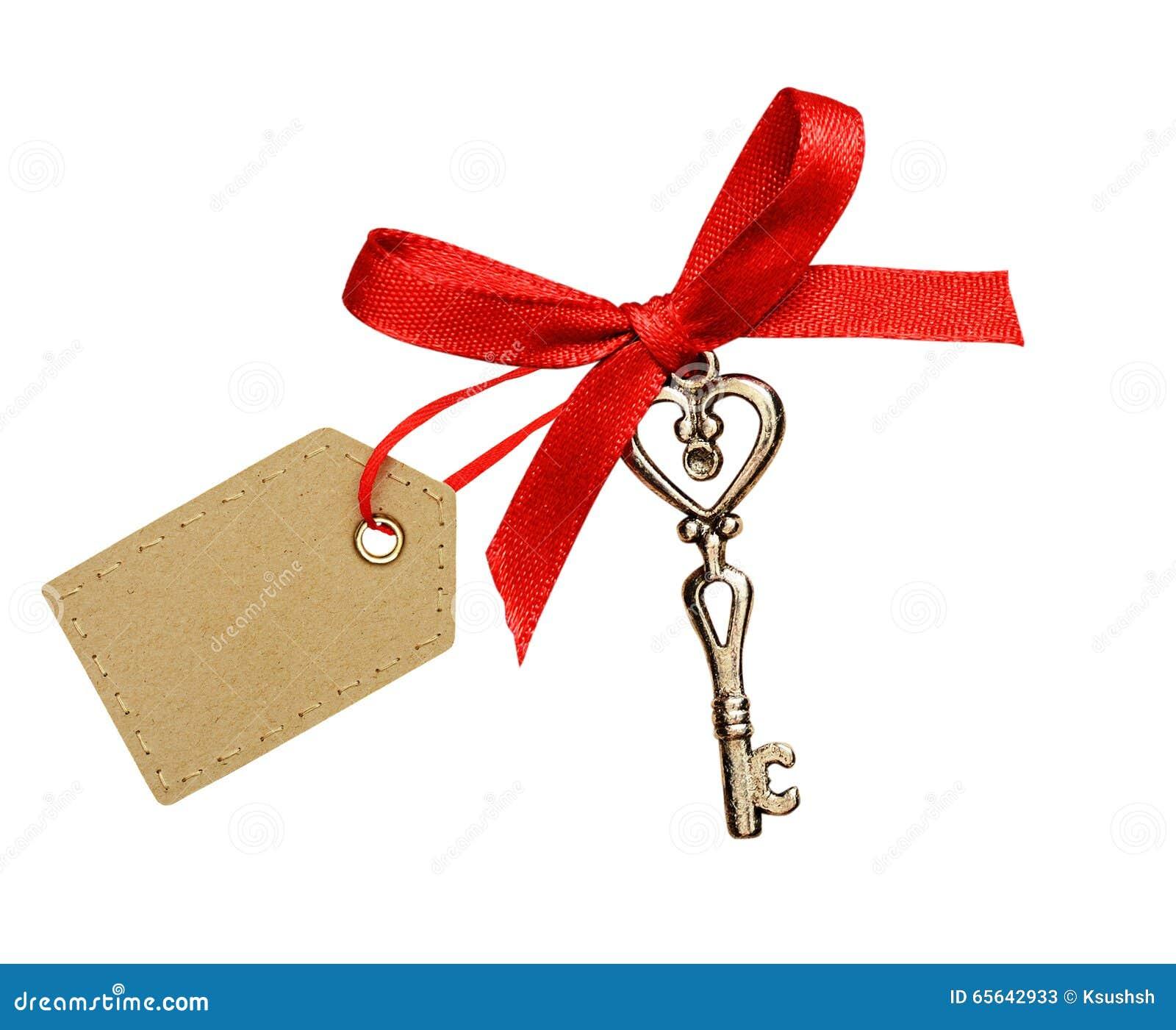 Ruban rouge, coeur de scintillement et une clé
