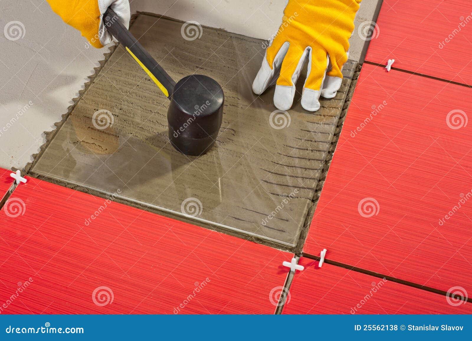 Rubber Hammer Install Glass Tiles Royalty Free Stock