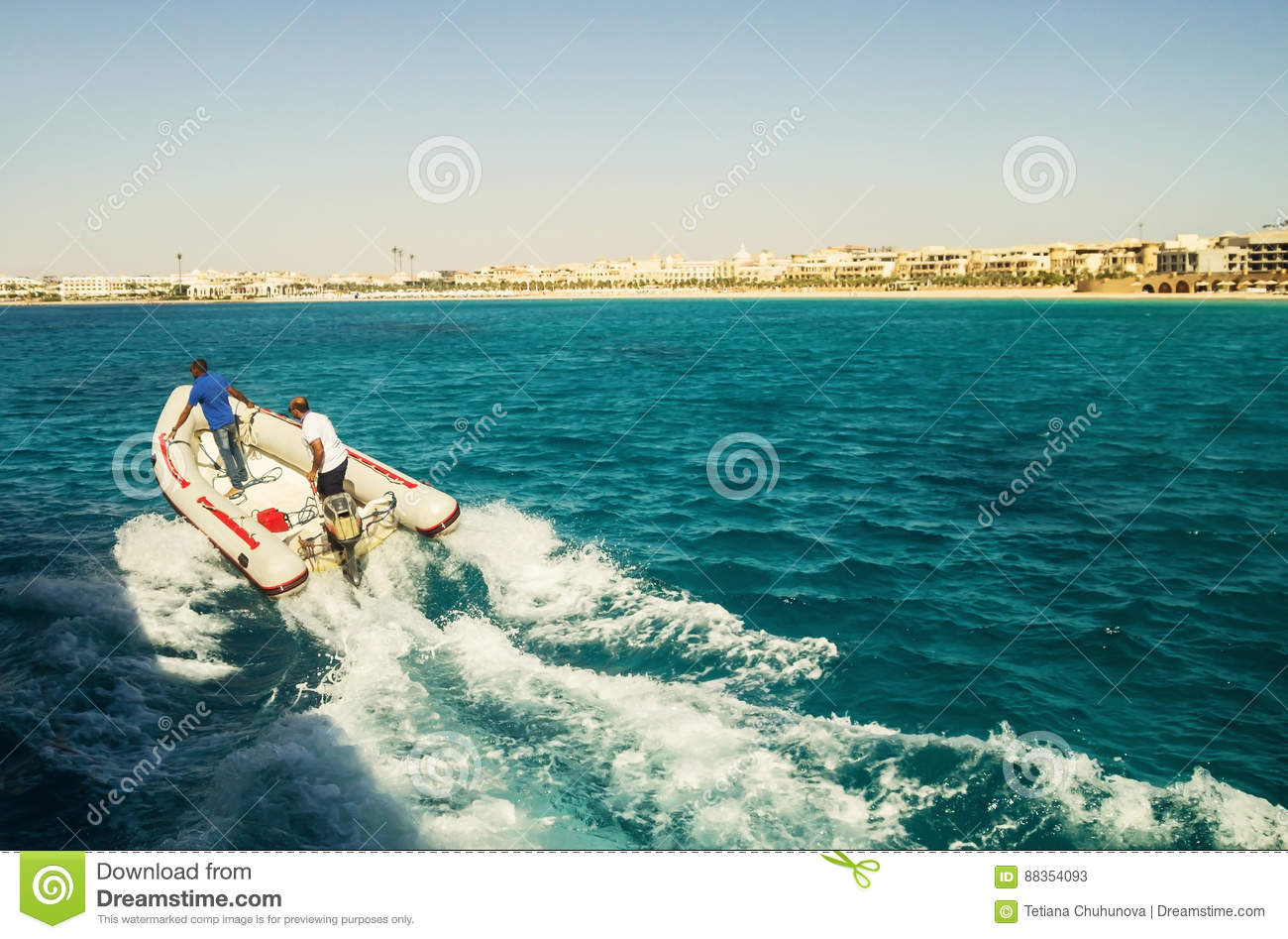 Rubber Motor Boat With Two Men At High Speed Sails By Sea Editorial ...