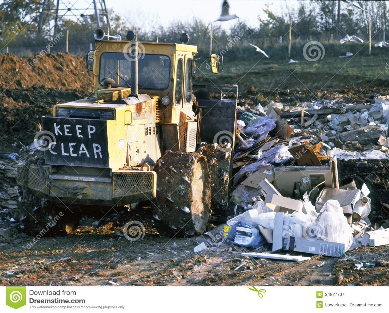 Rubbish Tip At Landfill Site With Bulldozer At Work Stock