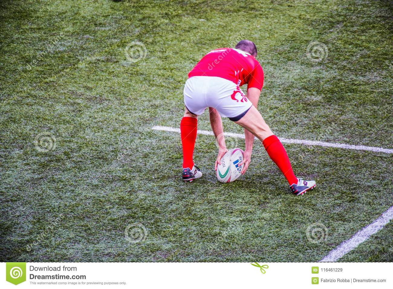 Rugby player grabs the oval ball