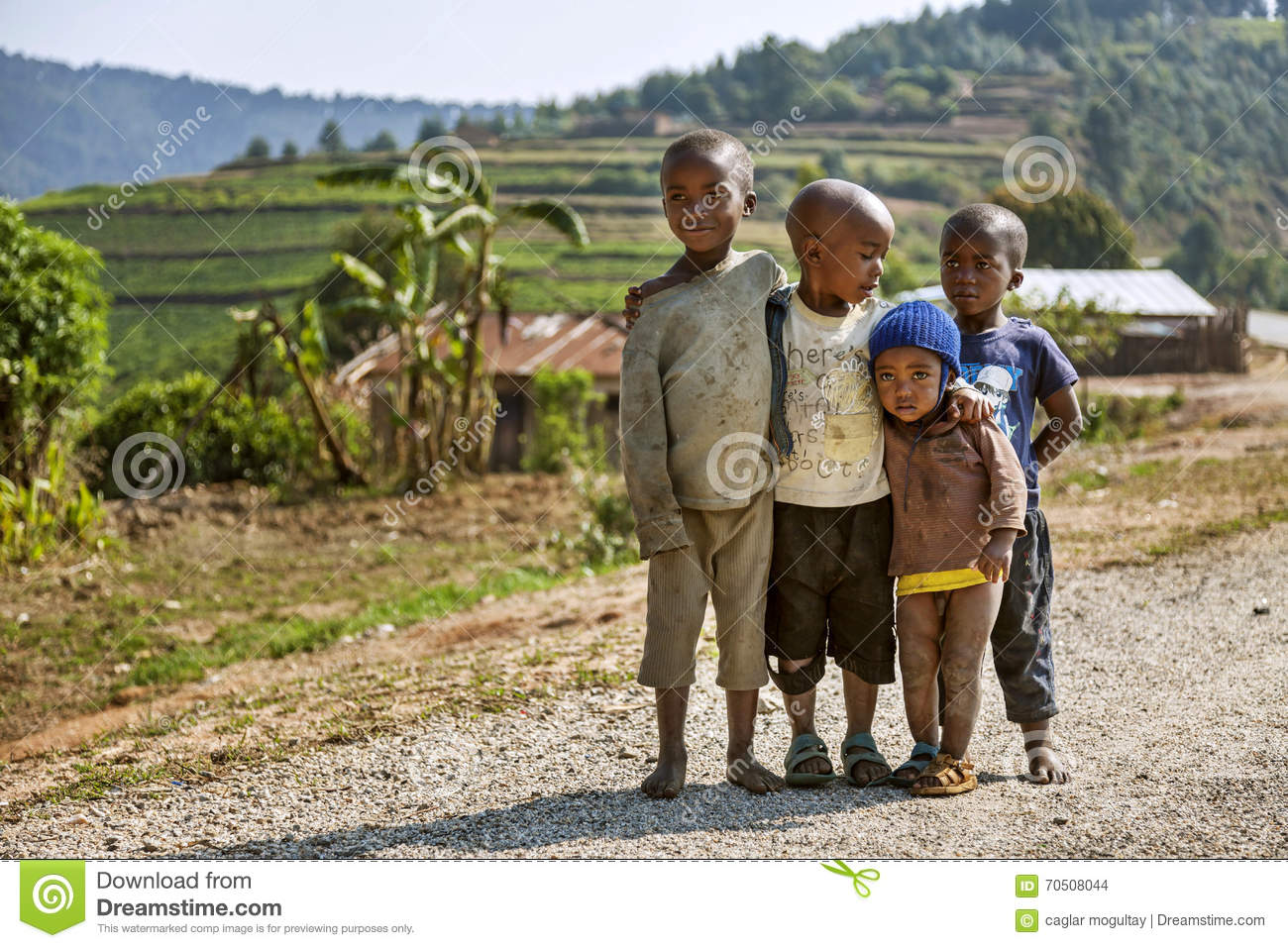 naked childrren RUHENGERI, RWANDA - SEPTEMBER 7, 2015: Unidentified children. The African  children stick