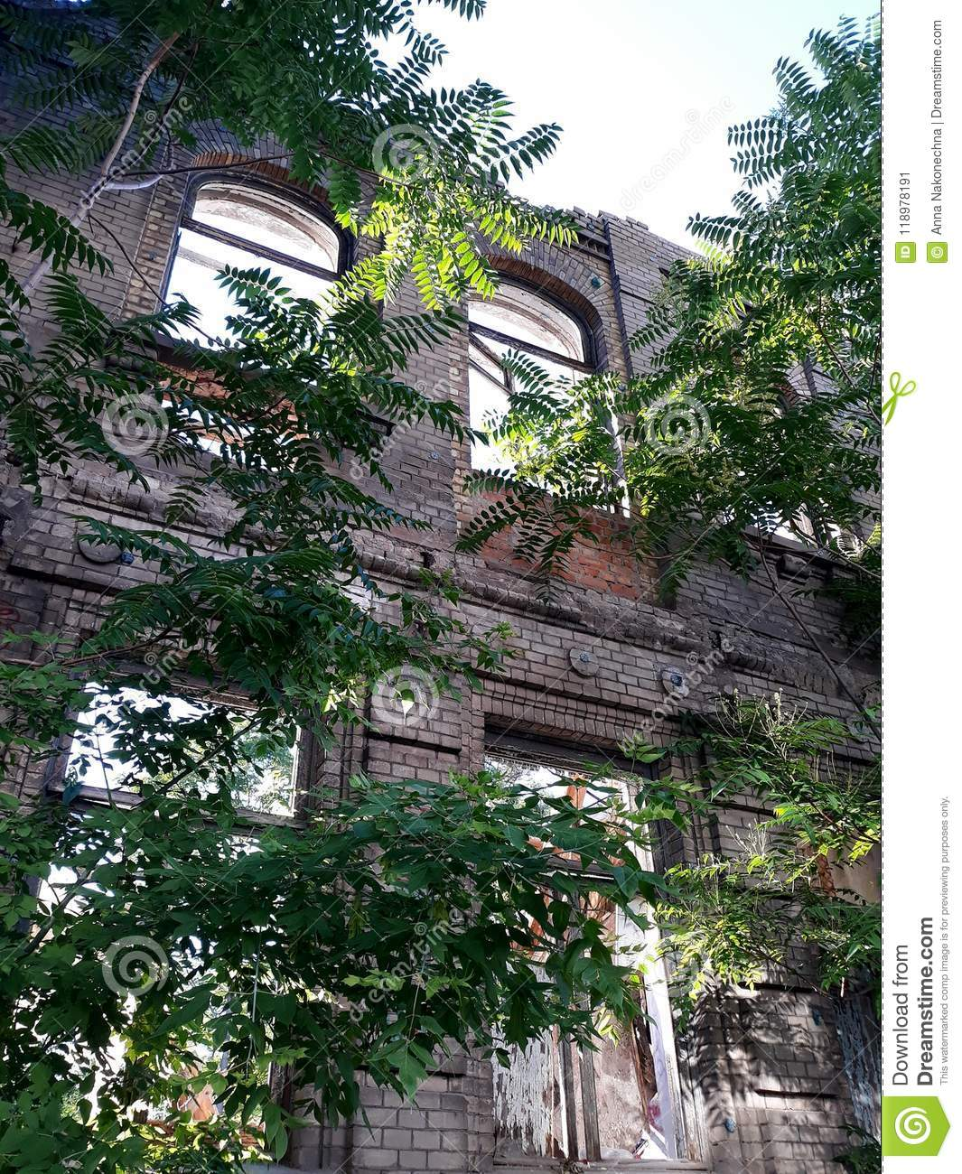 The Ruined Facade Of An Old Brick Building Stock Image