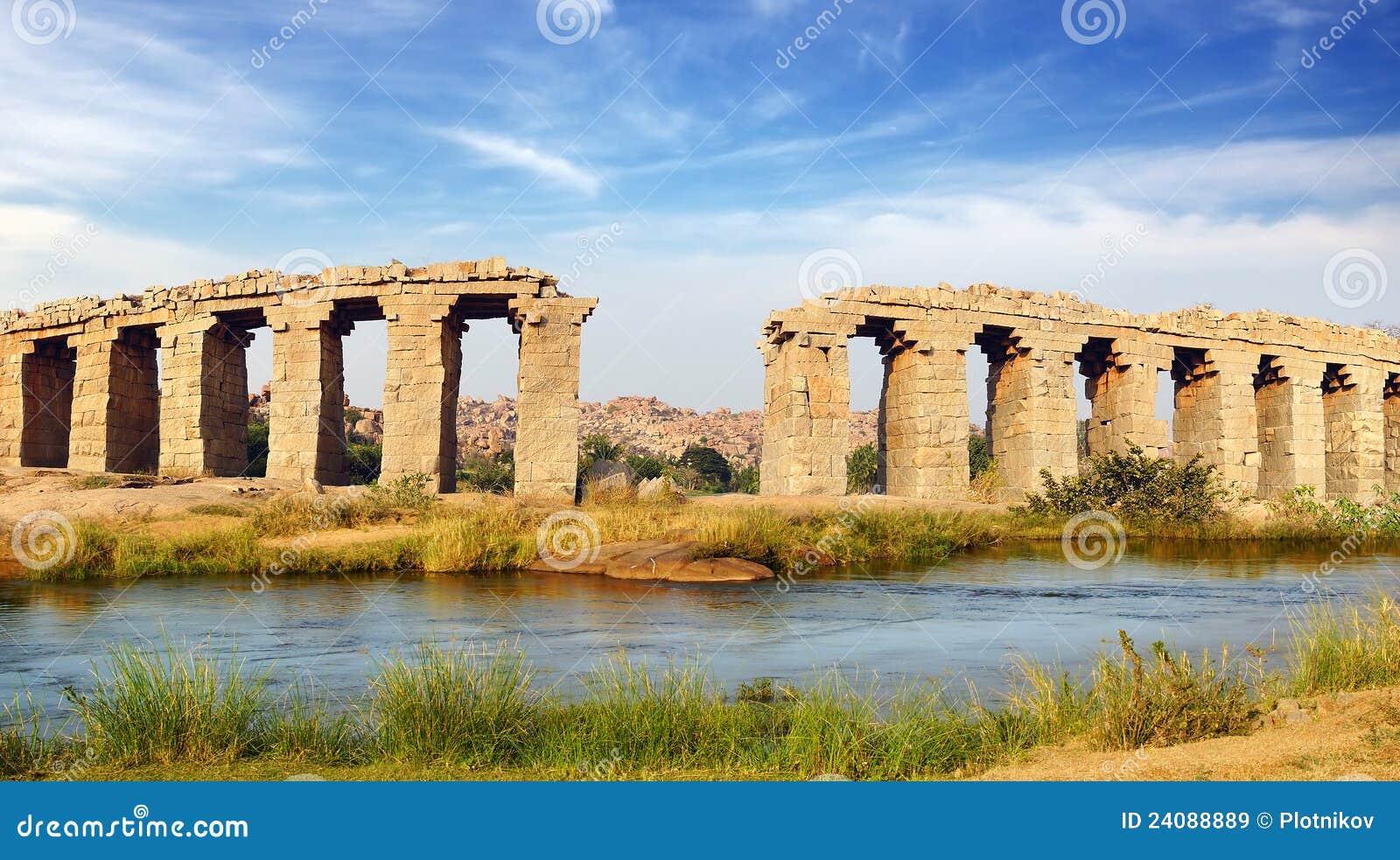 Ruins of ancient bridge. Hampi, India.